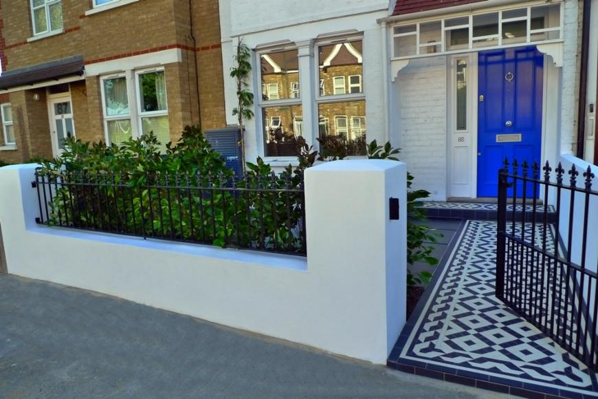 Clapham brick wall and metal rails landscape garden for Small brick wall designs front garden